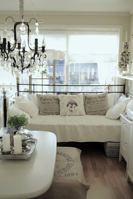 Shabby French Decor: Rustic Chandelier, Iron Day Bed, Decorative French Scripted Pillows & Burlap Ottoman