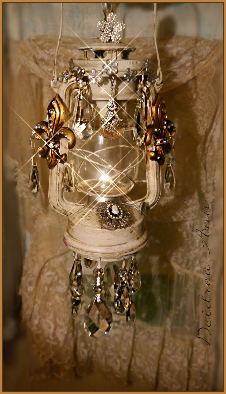 Chantern..a chandelier lantern. Made with a repurposed old lantern, jewelry and prisms.