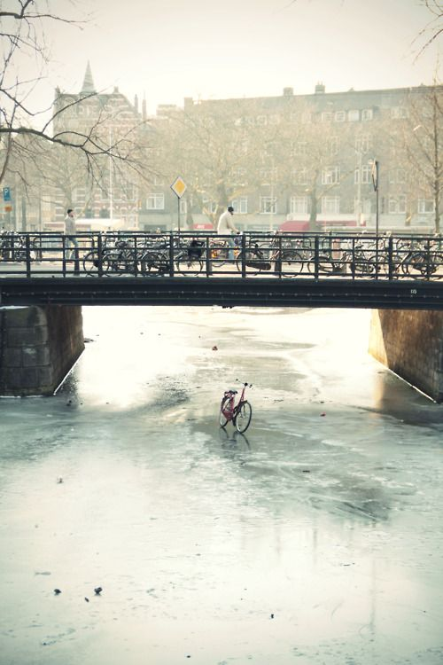Bicycle on frozen channel, Amsterdam, The Netherlands.