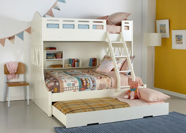 Kids white Snow Bunk bed with trundle and built in shelving, pastel coloured patterned linen and décor. Available at Forty Winks.