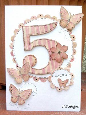 People seldom do number-cards anymore. This one is sweet with pretty pink paper and few butterflies.