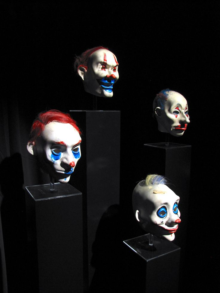 Eerie joker bank robber masks at the exhibit