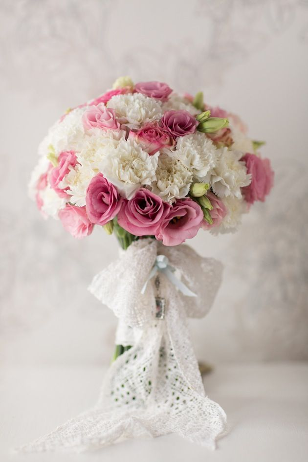 Stunning bouquet tied with vintage lace (more than 50 years old) made by the bride's grandmother!  photo by @Brancoprata | see more here: http://bridalmusings.com/2013/09/pretty-pastel-hued-wedding-in-portugal/