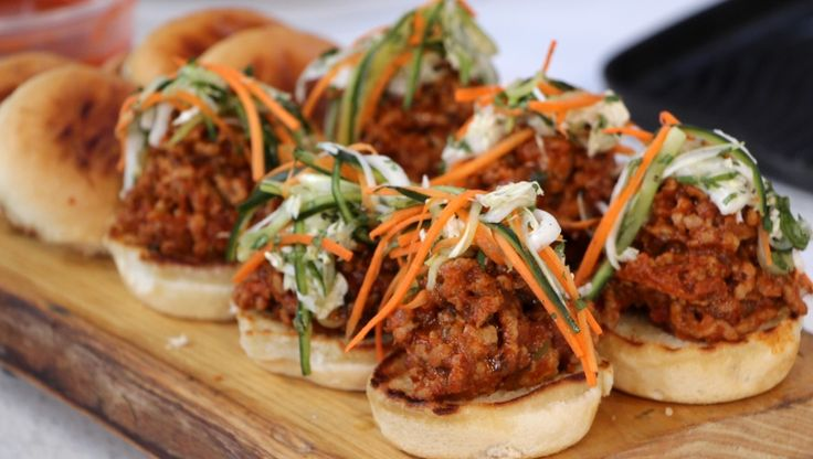 Serve these very sloppy, sloppy joe toasted sliders filled with a super flavorful sloppy joe mixture and coleslaw, perfect for your next dinner party.
