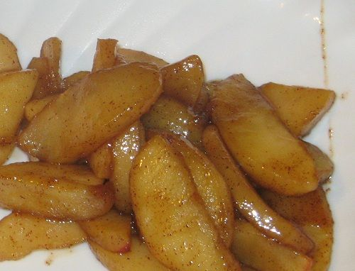 Fried Apples:  •2 Tablespoons butter  •6-8 apples (I imagine most any variety would work, except red and golden delicious.)  •1/4 cup brown sugar  •1 teaspoon cinnamon  Peel and slice apples.  Melt butter in a heavy skillet.  Add apples, brown sugar, and cinnamon.  Saute on medium (maybe medium-low) heat for 15-20 minutes, stirring frequently.  Serve warm.