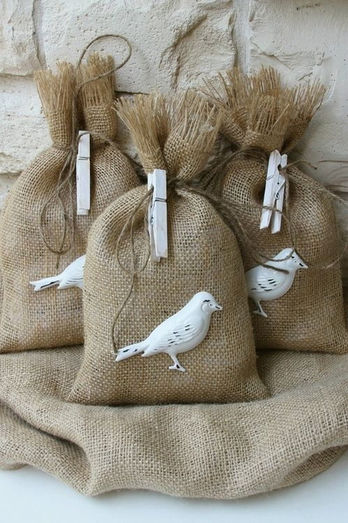 Charming burlap gift bags adorned with little distressed metal birds!