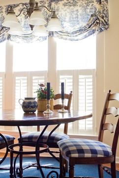 blue and white Toile Kitchen shade and buffalo check chair seat.  wrought iron breakfast table set
