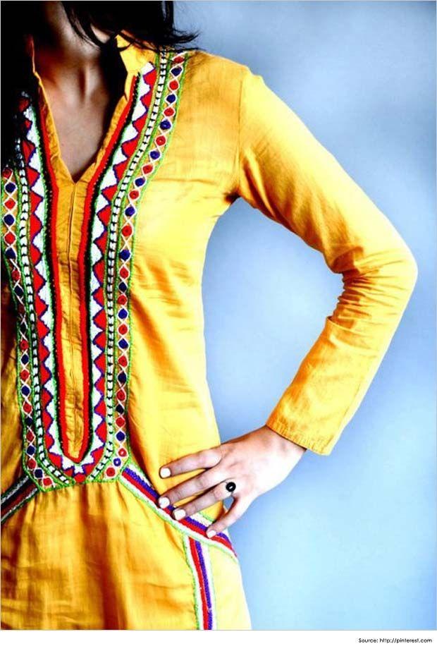 colorful embroidery on yellow kurta