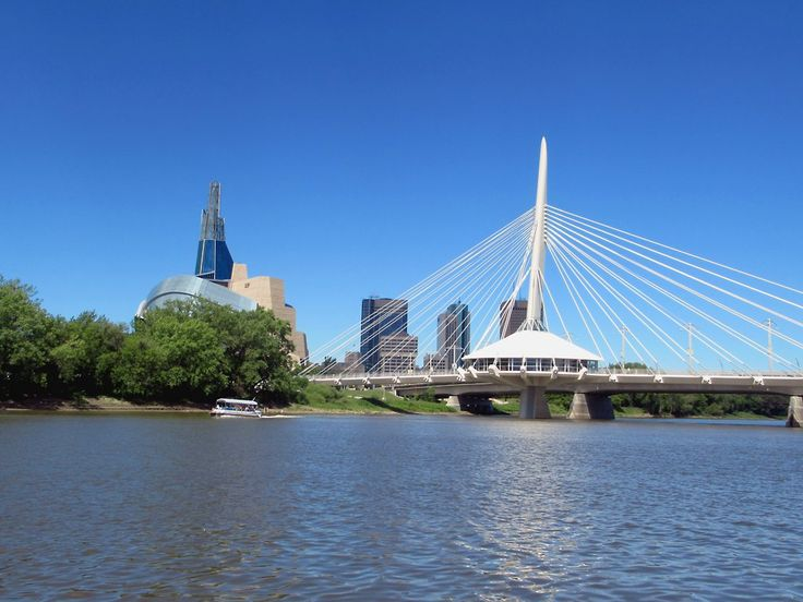 The stylish Esplanade Riel Footbridge (2003) crosses the Red River from St Boniface to The Forks at Winnipeg, Manitoba, Canada.