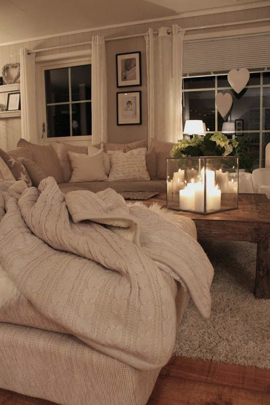 Elements of a Cozy Home - big wooden coffee table, candles, sweater blankets