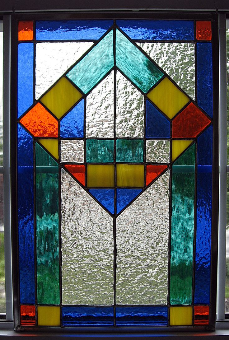 Classic geometrical stained glass panel. $85.00, via Etsy.