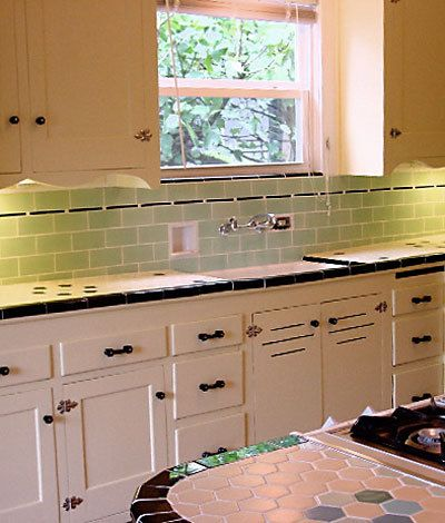 Trying to decide between green or white subway tile ... for green/black counter, white cabinets... walls can be same green or a pale honey yellow tan.