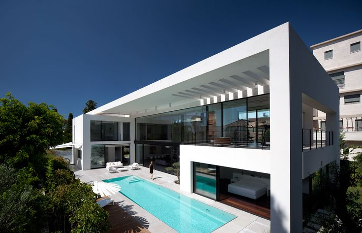 Contemporary Bauhaus on the Carmel by Pitsou Kedem Architects. Water body by one of the houses.