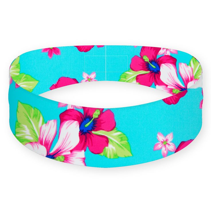 """Feel like you're living the island lifestyle wherever you are with the Island Fever headband. The tropical flower pattern gives you a relaxed Hawaiian look and the non-slip, perfect fit makes sure your headband will give you, """"no problem, no trouble"""" or as the Hawaiians say, """"'A'ole pilikia."""""""