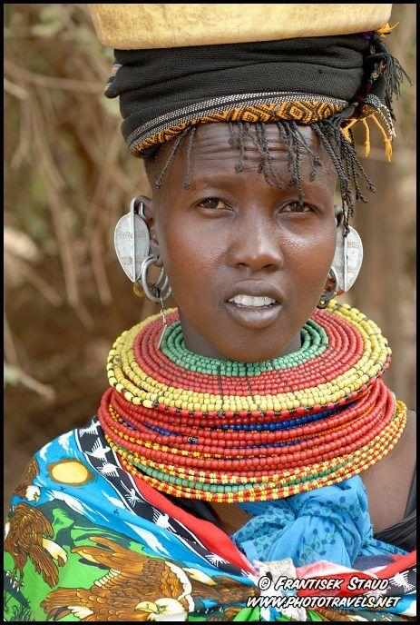 Photograph of Beautiful Samburu girl carrying plastic barrel on ...