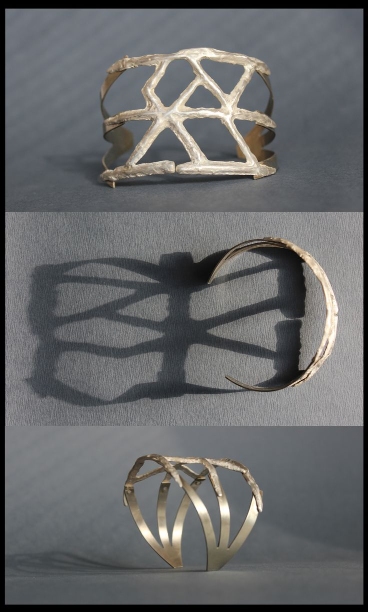 """Bracelet made from white brass- alpaca and silver  """"Fifth Bindrune in a series of six: the central part of the bracelet's surface smooths, civilize, alpaca continues in a clawed shape. It is a contrast and penetration of the past and present. Visible riveting underneath seems to undermine the possibility of peaceful coexistence of tradition and modernity"""" Meaning behind the bracelet: #success #endurance #safejourneys"""