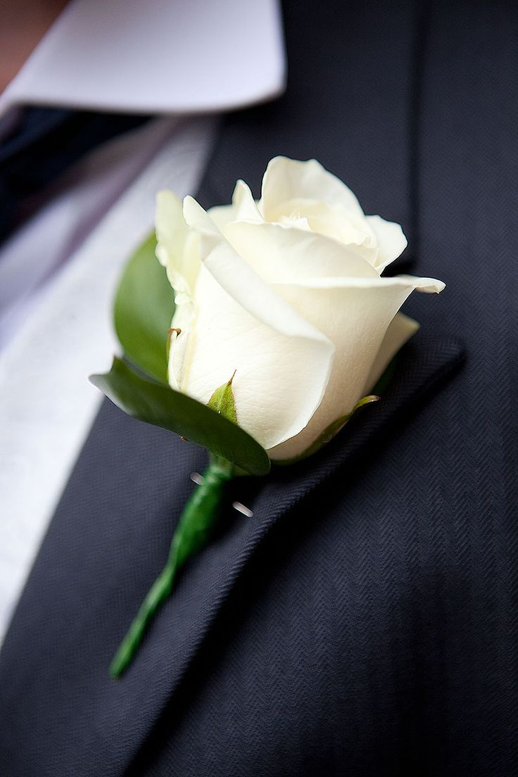 Boutonniere: The men (including fathers of the bride and groom) will wear a simple white rose boutonniere