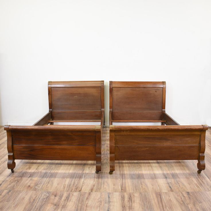 This pair of empire bed frames are featured in a solid wood with a glossy medium cherry finish. These twin sized sleigh beds are in great condition with curved edges, carved feet and rolling caster wheels. Elegant beds perfect for a guest room! #victorian #beds #bedframe #sandiegovintage #vintagefurniture