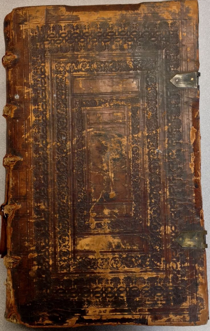 Corpus juris civilis (1612) in wooden boards, brown embossed calf leather, with  fragments of clasps and metal corner-pieces.