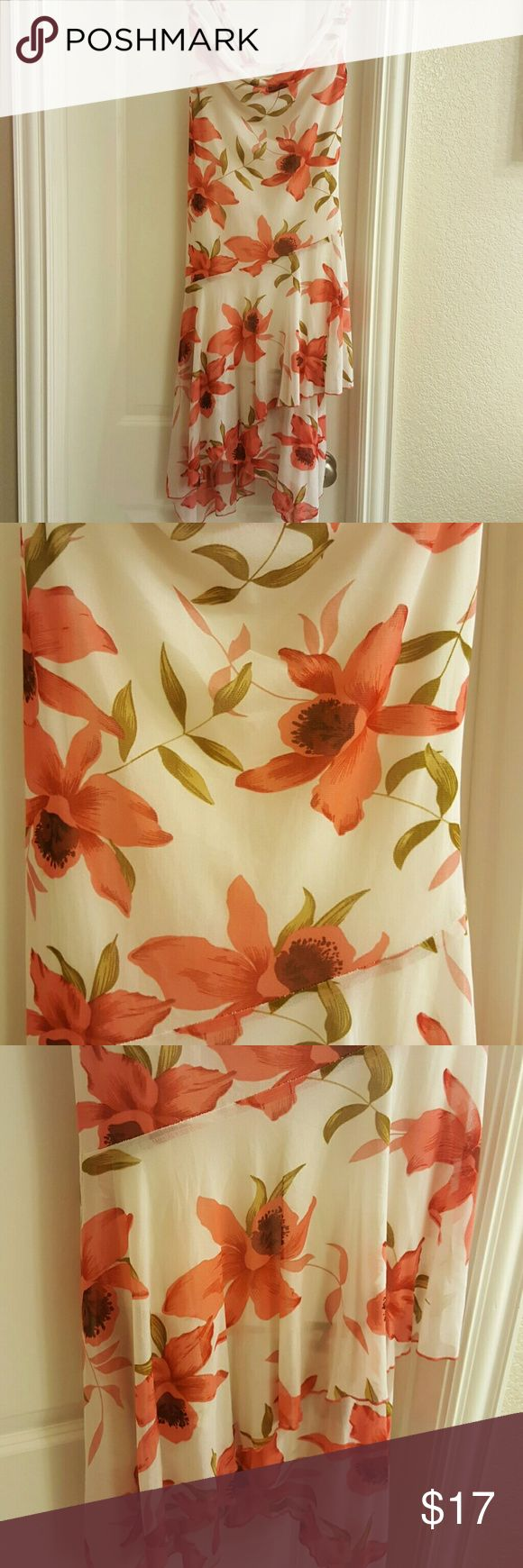 Beautiful summer dress Flowing peach flower dress, perfect for a summer date. You will look fabulous in this little number. Dresses