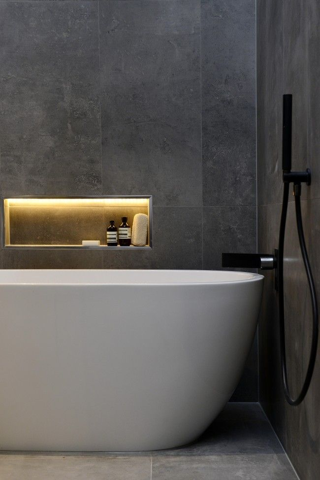 Elegant detail of #white #tub in a #dark #marble #Bathroom
