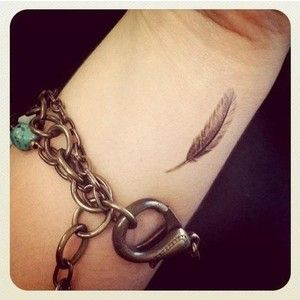 Small feather tattoo on the arm. #tattoo #tattoos #Ink