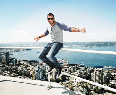 Russell Wilson poses on top of the Space Needle for Men's Health magazine.