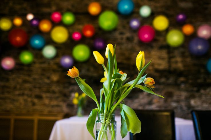 Colourful wedding in the Lake District. Multicoloured lanterns, ribbon and daffodils!  (copyright of ink and pixels creative)