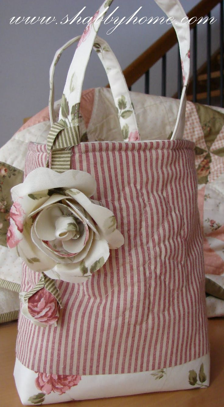 Super cute bag. Like the flower design sewn onto it. fabric & flower bag