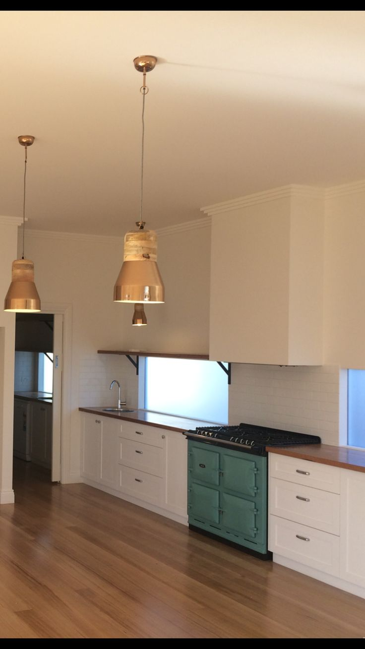 Our kitchen: pistachio green AGA six four, shaker style cabinets, recycled messmate bench