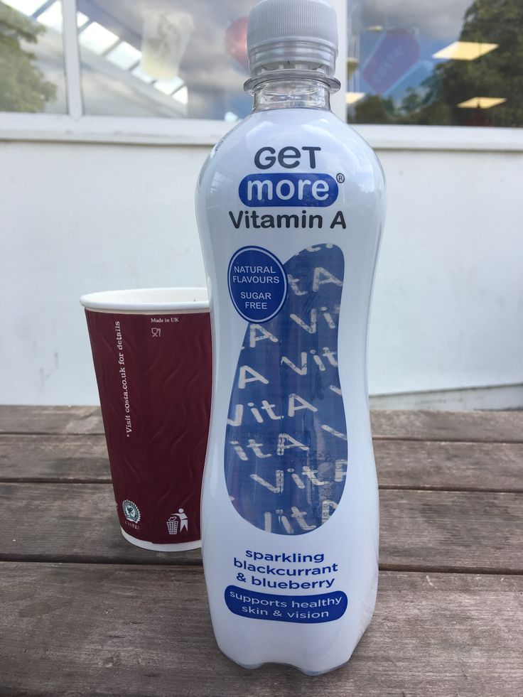 Get More Vitamin A sparling blackcurrent and blueberry drink by More Drinks. Made in the UK. Made in UK Costa disposable cup in the background.