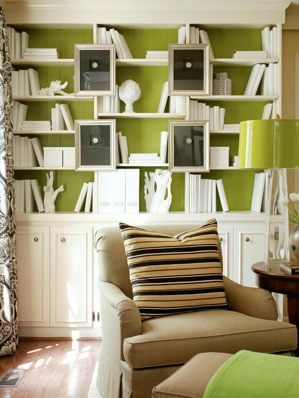 Bright Chartreuse: Spiced-Up Bookshelves  Make a bold and colorful impact on a bookshelf through more than just your book arrangement. Here, designer Tobi Fairley paints the backs of the built-in a citrusy chartreuse hue. To ensure the color stands out, each book is outfitted in a white book cover next to all-white accessories. The green backdrop is now a can't-miss element of this living room.