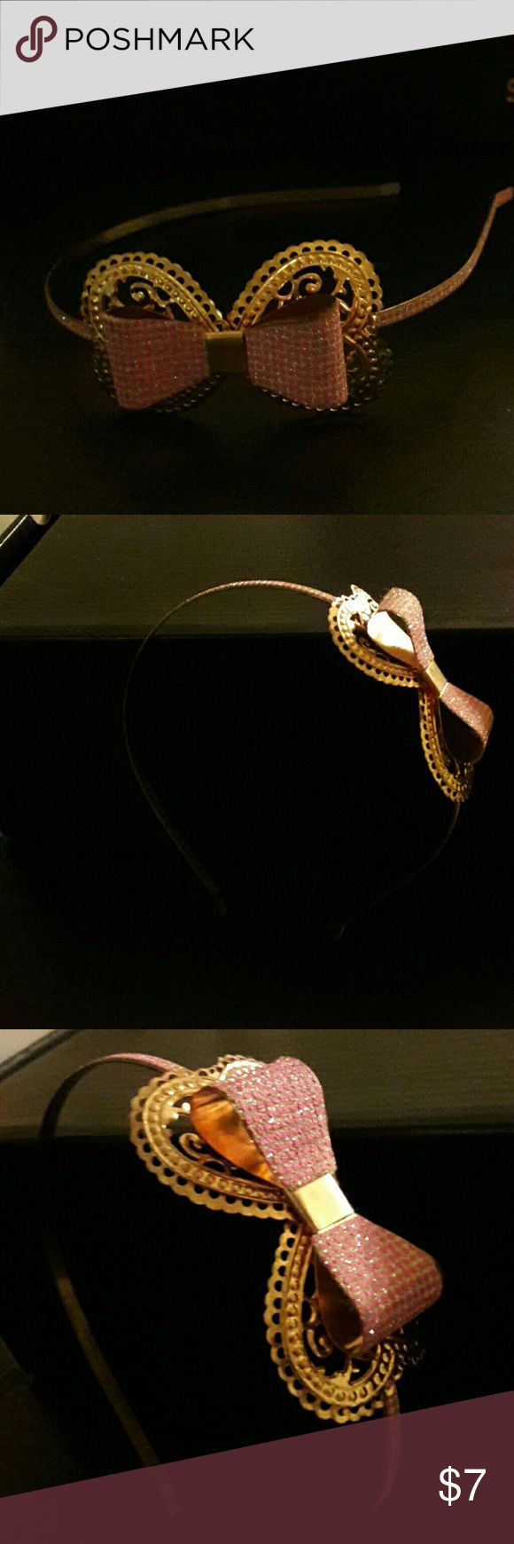 Pink bow metal headband Pink bow metal headband. Never used. Accessories Hair Accessories