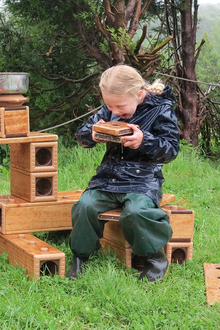 How do the children at Each Peach Childcare receive endless creative opportunities outdoors?