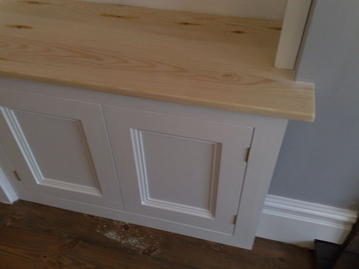 Becky Bell Cabinetmaker Bespoke kitchens London: Alcove cabinets - boxing in meters in lounge.