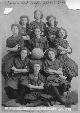 Photograph of the Woodward Girls Basketball team from 1910.  Their uniforms include stockings and what seems to be  a bracelet on the left wrist. (Plains Indians & Pioneers Museum)