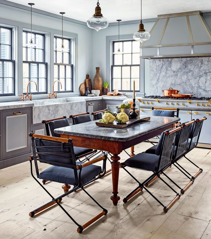 """I love vintage and industrial lighting in a kitchen,"" Gambrel says. ""It tones down the seriousness. Plus, pendants draw light down and cast a glow in all directions. I never use recessed lights in a kitchen— they're one-directional and not easy to work under."""