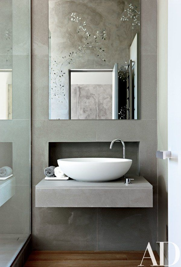 Glass mosaics, seen in the mirror, decorate the master bath in this contemporary London residence designed by Monica Mauti | archdigest.com