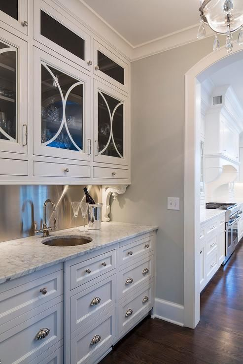chic butler 39 s pantry boasts white drawers adorned with
