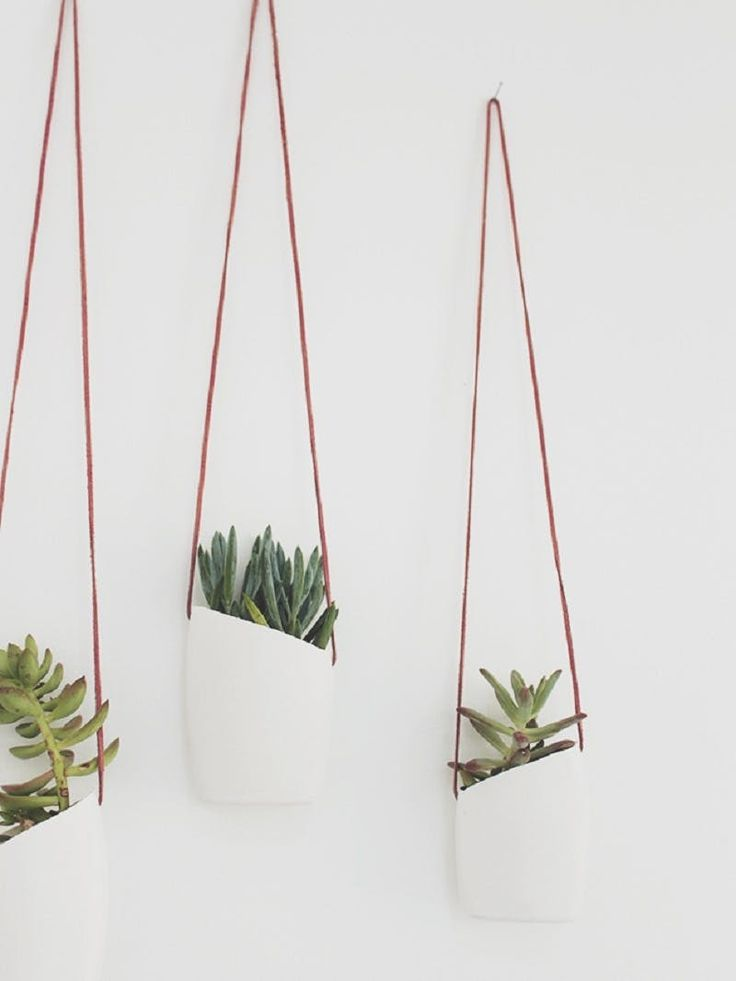 12 DIY Hanging Planters to Make | Plants can liven up a home like nobody's business, and hanging plants take that liveliness to a whole new level, literally. These 12 tutorials will help you transform clay, rope, wood slices, and even recyclables into functional, fabulous hanging planters.