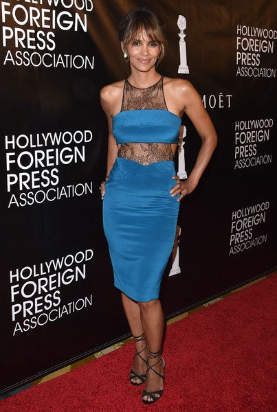 Halle Berry Strappy Sandals - Halle Berry kept it sizzling-hot all the way down to her black Jimmy Choo strappy sandals.