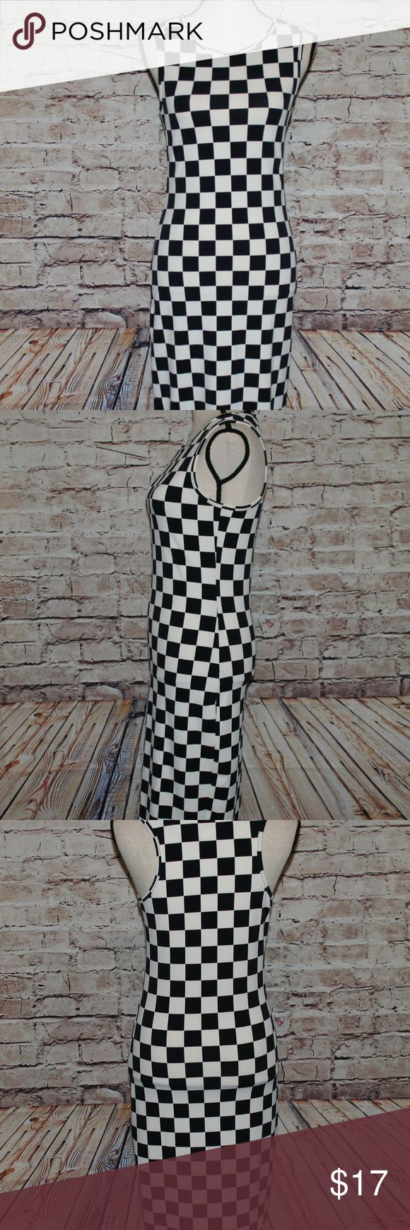 """FOREVER 21 Black and White Checkered Sheath Dress FOREVER 21 Black and White Checkered Sheath Tank Dress with Stretch Women's Medium  Sleeveless sheath dress Black and white checkered design Below the knee length 91% Polyester 9% Spandex Great condition!   **All items are carefully packaged and ship within one business day of confirmed payment!  Measurements: Bust: 32 Waist: 29""""  Length: 40""""       THANKS FOR STOPPING BY THE SMART SHOPPE! Forever 21 Dresses"""