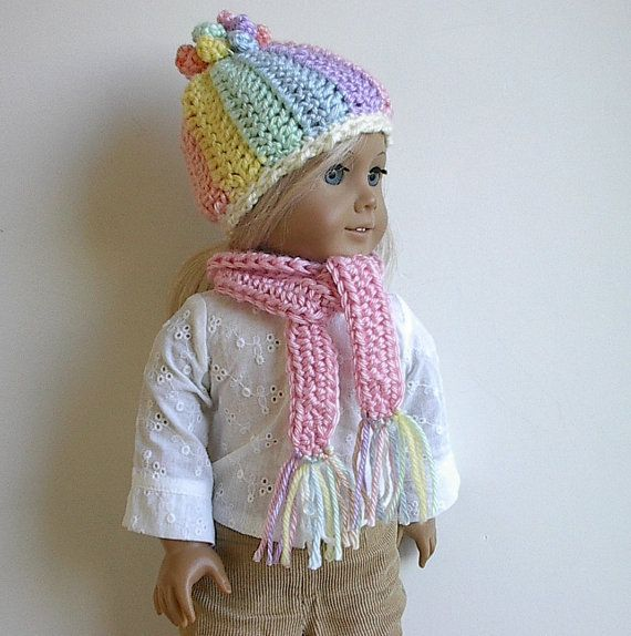 Crocheted Doll Hat and Scarf Set Pastel Colors with Corkscrew Topknot Handmade to Fit the American Girl and other 18 Dolls - Choose Scarf Crocheted with very soft Caron acrylic yarn in pastel shades of pink, peach, yellow, green, blue and cream, the hat is embellished with a crocheted curly corkscrew topknot incorporating all colors. You will select the color of the coordinating scarf that completes the set (see last photo). If you would like a pair of hand knit mittens connected with a…