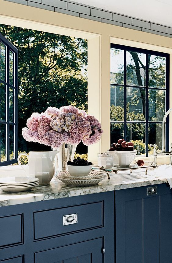 13 pretty kitchen windows. you're welcome. Love the cabinet color.