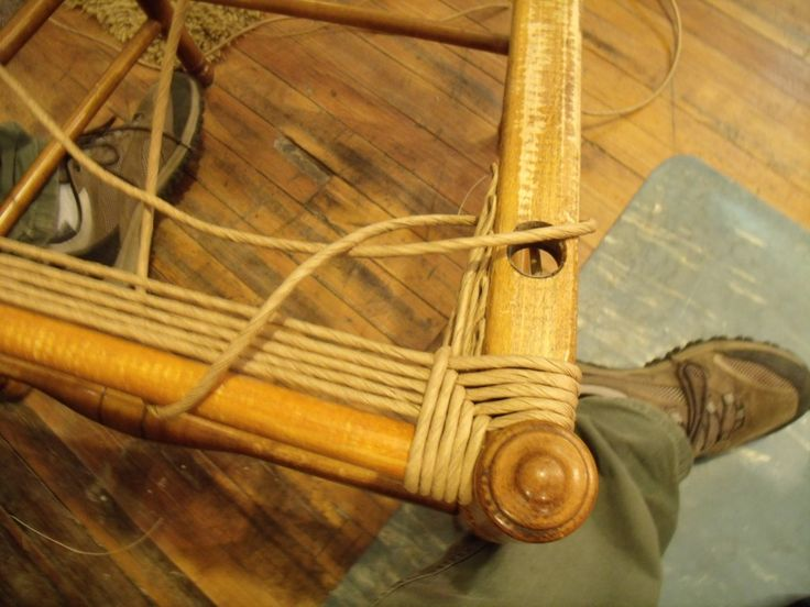 filling in the gussets of a paper rush armchair at Silver River Center for Chair Caning.