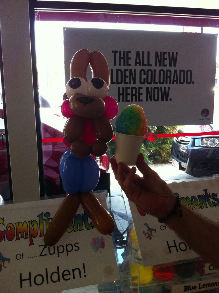 Zupps Mt Gravatt Sales Day. Snowy Joey chowing down on a rainbow colored snow cone.