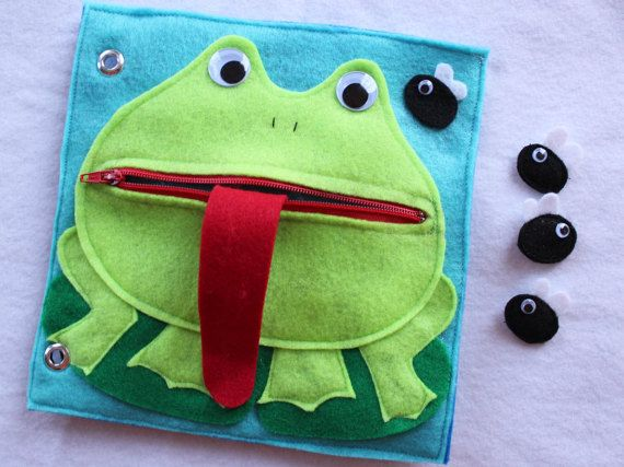 This listing is for Hungry Frog - a single page to add to your customizable book. Have fun zipping and unzipping the frogs mouth and feeding the frog some flies! Flies have velcro on the back of them to stick to the frogs long tongue. Quiet Books are a great way to keep your little ones occupied and learning during church, doctors appointments, traveling, or anywhere you need to keep your children quietly entertained! Unique and thoughtful gift idea! Expand and change your book with your…