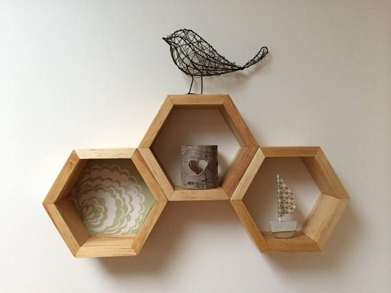 These hexagon shelves put the fun in functional! Their shape allows for a wide variety of arrangements, and they can be custom finished to suit your decor needs! Our smallest size, these modern wall shelves work great for displaying nick nacks, organizing spices in the kitchen, and as