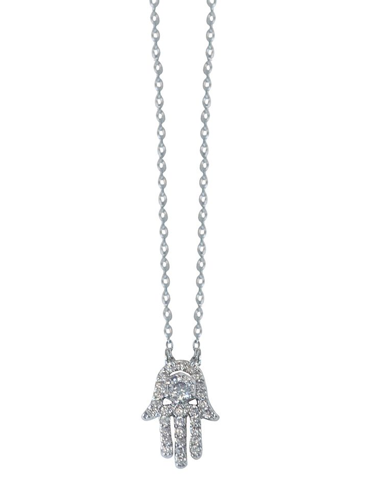 Mini Hamza Necklace -  INR 1,499 -  This delicate necklace features a delicate silver link chain that holds a tiny Hamza hand charm set with Cubic Zirconias. The necklace is dainty enough wear on its own everyday and is great for layering. #pendent #jewelry #necklace