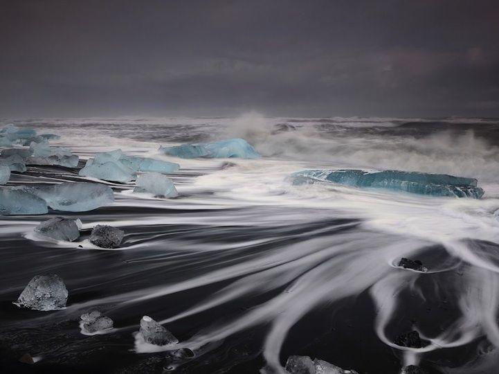 Turquoise Icebergs Dot Iceland's Black Sand Beach